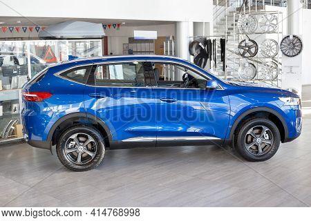Russia, Izhevsk - February 17, 2021: Haval Showroom. New Modern F7x Car In Dealer Showroom. Side Vie