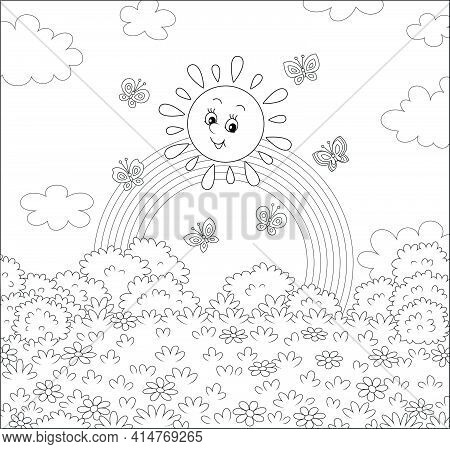 Friendly Smiling Sun With A Rainbow And Butterflies Merrily Flittering Over A Pretty Field With Flow