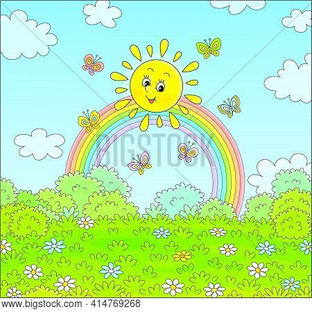 Friendly Smiling Sun With A Colorful Rainbow And Butterflies Merrily Flittering Over A Green Field W