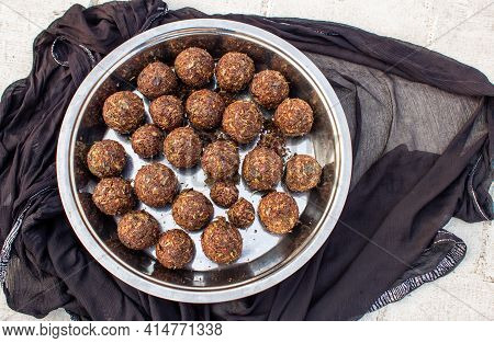 Round Balls Of Vadouvan (occasionally Spelled Vaudouvan) Is A Ready-to-use Blend Of Spices Used In C