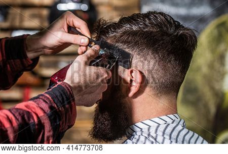 Hands Of Barber With Hair Clipper, Close Up. Bearded Man In Barbershop. Haircut Concept. Man Visitin