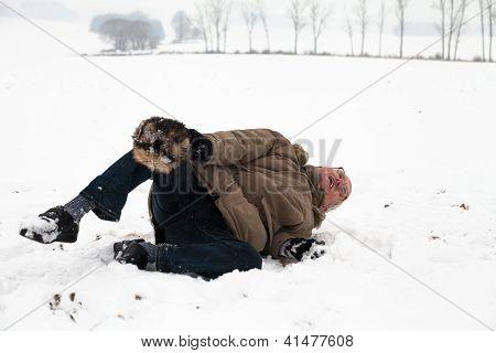 Senior Man Winter Accident Fall On Snow