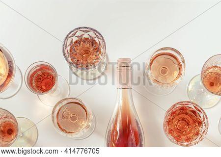 Rose Wine Assortment In Crystal Glasses, Bottle Of Rose Champagne Sparkling Wine. Summer Alcoholic D