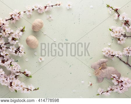 Easter Photo. Top View. Blooming Branch, Handmade Hare And Eggs On A Light Background