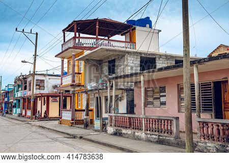 Baracoa, Cuba - October 25, 2019:  Old Cuban Man In Front Of His Accommodation (casa Particular) In