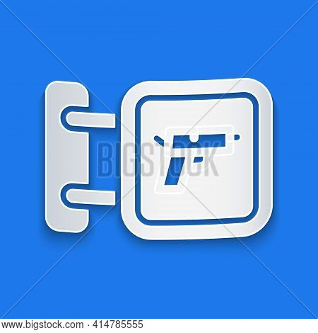 Paper Cut Hunting Shop With Rifle And Gun Weapon Icon Isolated On Blue Background. Supermarket Or St