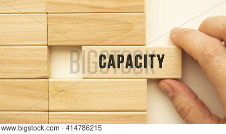 Hand Holds A Wooden Cube With The Text Capacity. Positive Thinking Concept