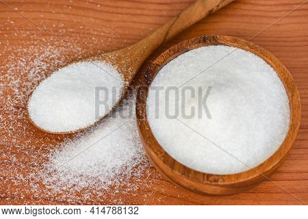 Monosodium Glutamate On Wooden Bowl And Spoon On The Table Background, Msg For Food Seasoning