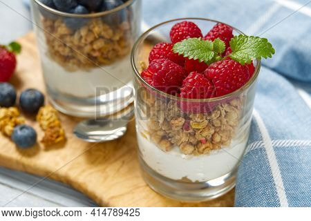 Yogurt With Granola And Fresh Blueberries And Raspberry, In Glass. Healthy Breakfast: Yogurt Parfait