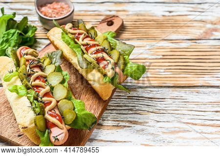 Various Hot Dog With Vegetables, Lettuce And Condiments. White Wooden Background. Top View. Copy Spa