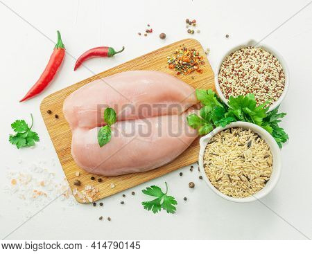Fresh Turkey Fillet. On A Wooden Board. Garnished With Herbs And Spices. Next To Them Are Cups Of Wi