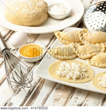 Process Of Making Sweet Dumplings With Cottage Cheese. Rolled Raw Dough Stuffed With Cottage Cheese