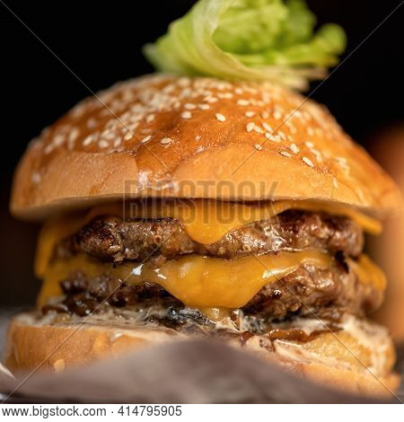 Double Meat And Cheese Burger, Close Up. Fresh Juicy Hamburger Made For Super Nutritious Snack Or Lu