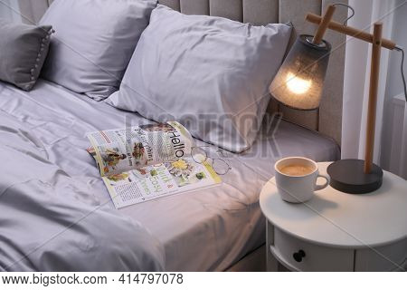 Magazine On Bed With Soft Silky Bedclothes In Room