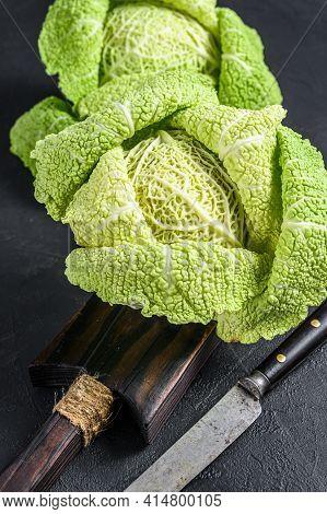 Fresh Healthy Savoy Cabbage. Dark Background. Top View