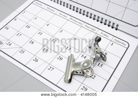 Bulldog Clips on Calendar with Grey Background poster