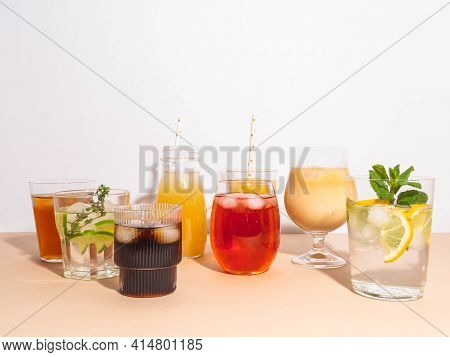 Various Refreshing Non-alcoholic Drinks In Glasses With Ice. Different Juice, Homemade Lemonade, Ice