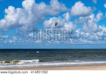 Baltic Sea, Russia, Kaliningrad Region, July 12, 2020. Surfer On The Sea. Storm Waves And Windsurfin