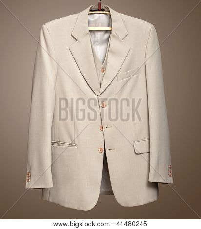 Beige jacket on hanger with Clipping path