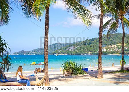 Phuket, Thailand - 12/29/2018: Coast Of Patong Beach With Palm Trees On A Sunny Day Overlooking The