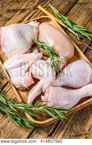 Fresh Raw Chicken Meat, Wings, Breast, Thigh And Drumsticks On A Wooden Tray. Wooden Background. Top