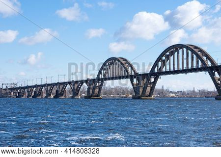 Metal Bridge Over The Dnieper River In The Ukrainian City Of Dnieper (dnepropetrovsk). Nice View Of