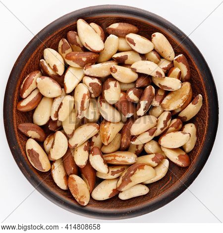 Brazil Nut In A Plate White Isolate Background