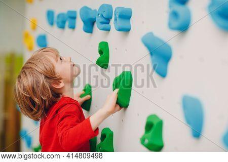 Kid Child Boy At Climbing Wall. Children Sport, Healthy Lifestyle In Kindergarten Or Sport Center In