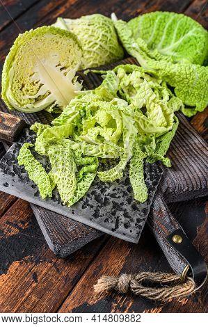 Cut Fresh Healthy Savoy Cabbage On Cutting Board. Dark Wooden Background. Top View