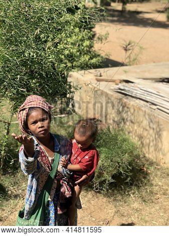 Bagan, Myanmar - November 4, 2019: Woman With A Child Asking For Money In Bagan, Myanmar