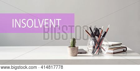Text Insolvent Is Written On A Folder Lying On A Stack Of Papers With A Pen On The Table. Business C