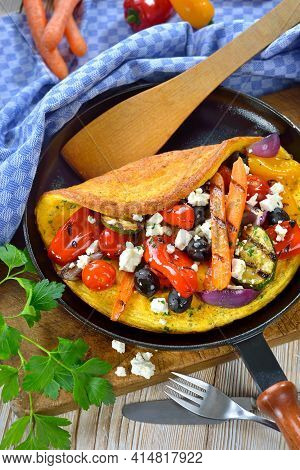 Omelette Greek Style With Grilled Vegetables And  Feta Cheese Served In A Frying Pan