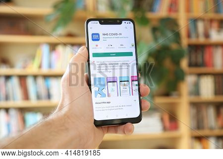 Warsaw, Poland - January 29, 2021: User Installing Nhs Covid-19 App On An Android Os, Xiaomi Brand S