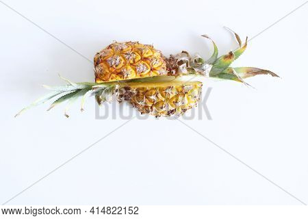 Two Halves Of Pineapple Fruit Isolated On White Background. Fresh Raw Ripe Fruit.top View. Fruit Con