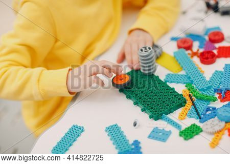 Smiling Kid Child Constructor Checking Technical Toy. Children Robotics Constructor Assemble Robot.