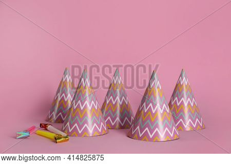 Colorful Party Hats And Blowers On Pink Background