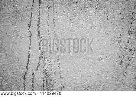 The White Concrete Stone. Concrete Plastered Stucco Wall Painted. The Cement Wall Background Abstrac