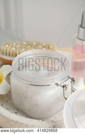 Jar Of Exfoliating Salt Scrub On Tray