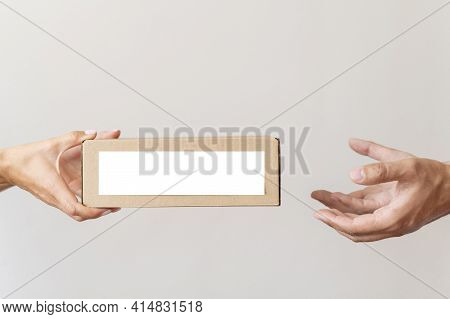 Hand Giving Donation Box Needy Person. High Quality And Resolution Beautiful Photo Concept