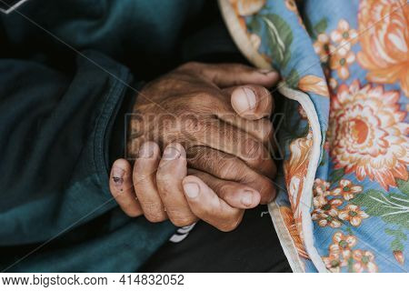 Homeless Man Holding His Hands With Blanket. High Quality And Resolution Beautiful Photo Concept