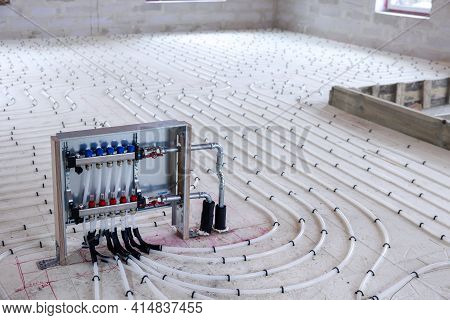 Underfloor Heating System - Water Pipes With Collector On The New Building Floor