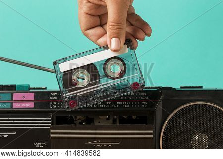 Inserting Tape Into Cassette. High Quality And Resolution Beautiful Photo Concept