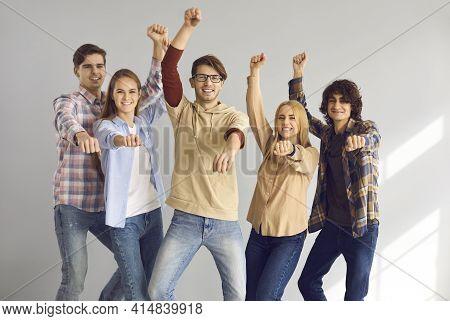 Studio Shot Of Bunch Of Happy Young Friends Having Fun And Dancing Gangnam Style