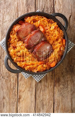 Serbian Baked Sauerkraut Podvarak With Smoked Pork And Bacon Closeup In The Pan On The Table. Vertic