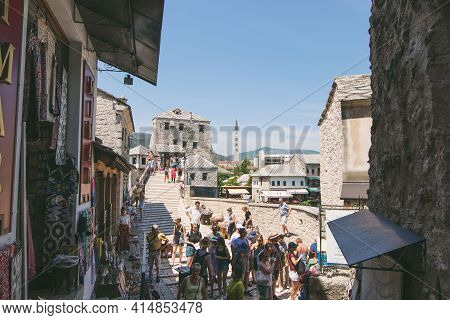 Mostar, Bosnia And Herzegovina-may 29, 2018: People Walking Through The Old Town With Many Shops And