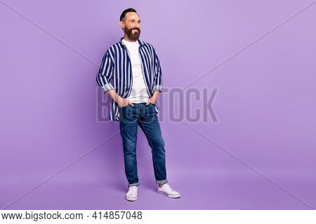 Full Body Photo Of Mature Man Look Copyspace Put Hands Pockets Isolated Over Violet Color Background