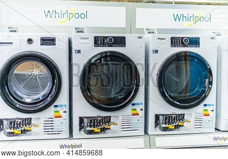 Poznan, Pol - Feb 24, 2021: Front-loader Washing Machines By Whirlpool Put Up For Sale In A Househol
