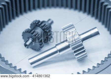Close-up Scene Of Planetary Gear  Gear Part In The Light Blue Scene. The Automatic Transmission Part