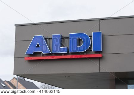 Sint Gillis Waas, Belgium, 28 March 2021, Logo And Name Of The Supermarket Chain Aldi On The Roof Of