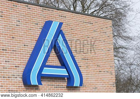 Sint Gillis Waas, Belgium, March 28, 2021, Logo Of The Supermarket Chain Aldi On A Stone Wall